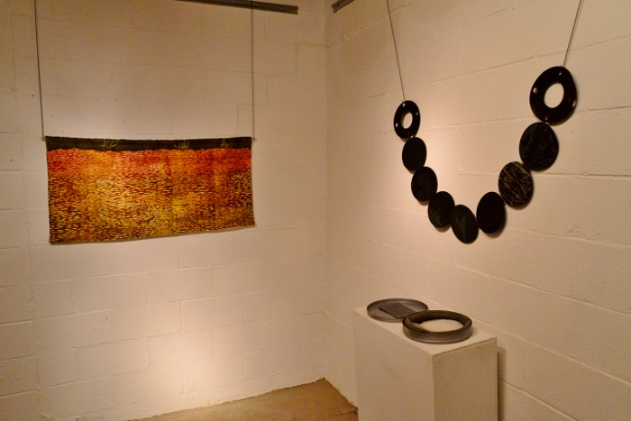Art hangs on the wall at 3rd Space Gallery. Photo by Page Graham.