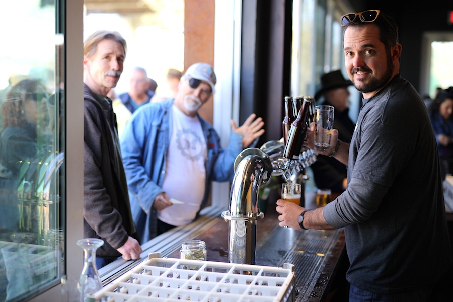 Zac Harris serves up Alamo Beer at the grand opening of the Alamo Beer Company brewery. Photo by Scott Ball, courtesy of Alamo Beer.