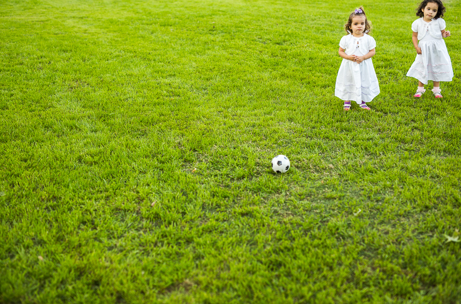 Two girls play with a soccer ballat the Travis Park Dinner en Blanc. Photo by Scott Ball.