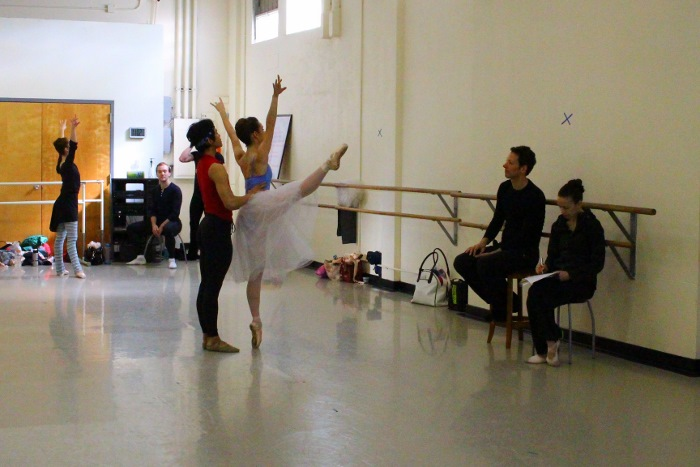 Philip Neal and Amy Fote work with dancers rehearsing Balanchine. Photo by Tami Kegley.
