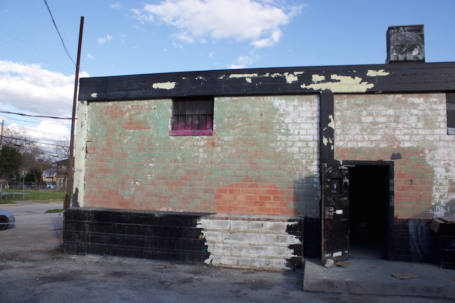 The wall of the Paper Tiger's small-stage wing on March 12, 2015. A site worker expressed the hassle of removing the innumerable layers of paint. Photo by Hunter Bates.