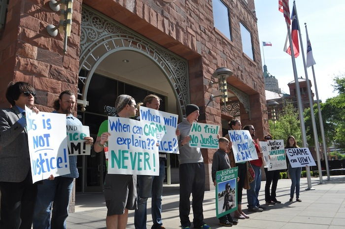 UIW students and friends of Cameron Redus protest outside District Attorney Nicolas LaHood's office. Photo by Iris Dimmick.