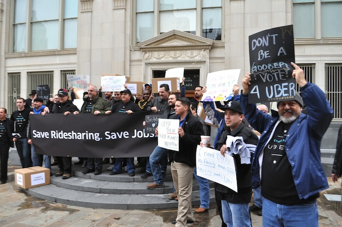 Uber supporters rally outside City Council Chambers. Photo by Iris Dimmick.