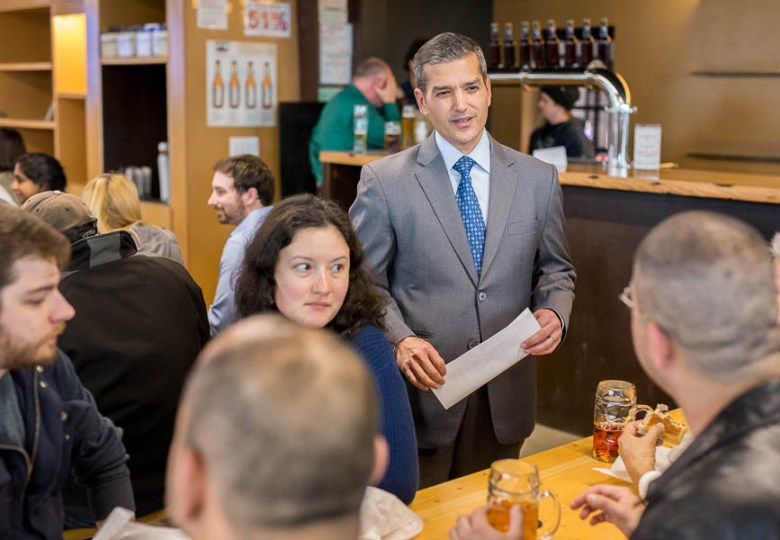 Mayoral candidate Mike Villarreal speaks with attendees before the Pints & Politics mayoral forum at the Alamo Beer brewery. Photo by Scott Ball.