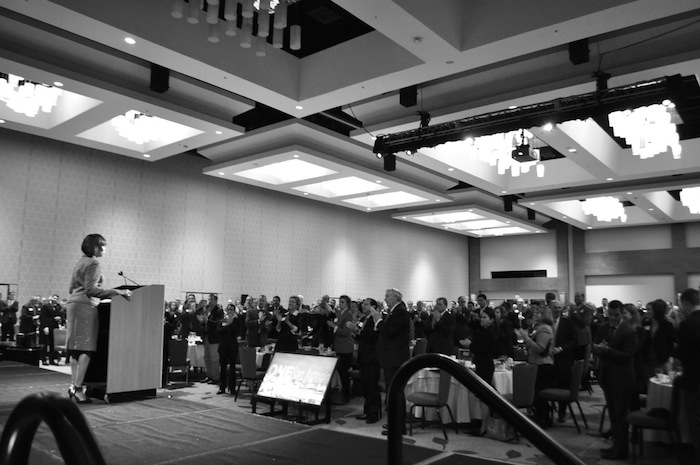 Mayor Ivy Taylor receives a standing ovation as she approaches the dais to deliver her 2015 State of the City address. Photo by Iris Dimmick.