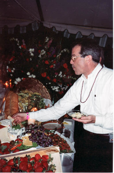 A guest enjoying some samples from the cuisine court.  Photo provided by WEBB archives.