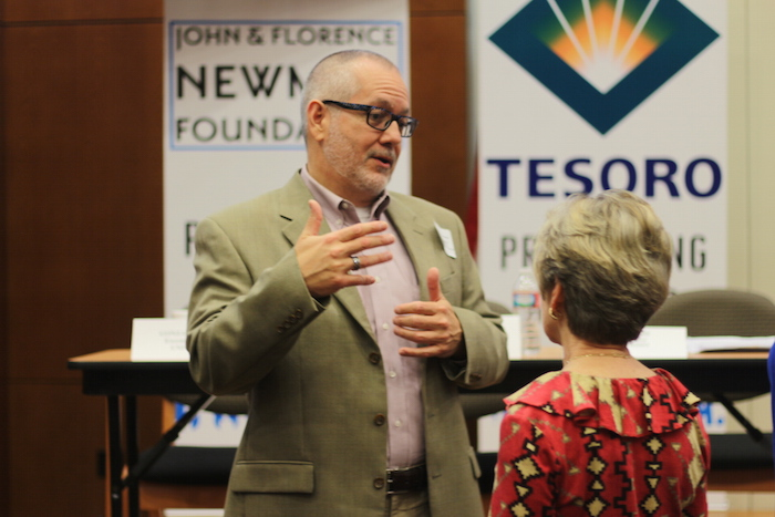 Scott McAninch, the Executive Director of the San Antonio Nonprofit Council, speaks with an audience member during The Big Give's women in media workshop. Photo by Joan Vinson.