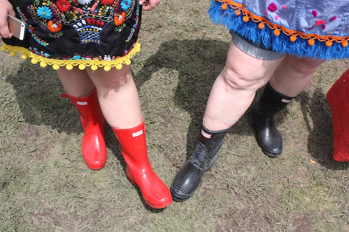 Rain boots help keep feet dry as Friday's rain created mud trails for attendees during the 2015 Fiesta Oyster Bake on Saturday. Photo by Kay Richter.