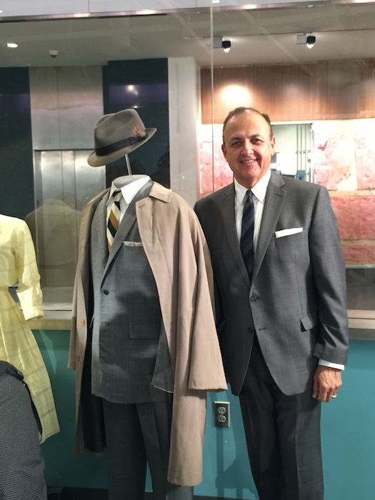 """Al Aguilar stands with an iconic Don Draper suit from """"Mad Men."""" Photo by Gisela Girard."""