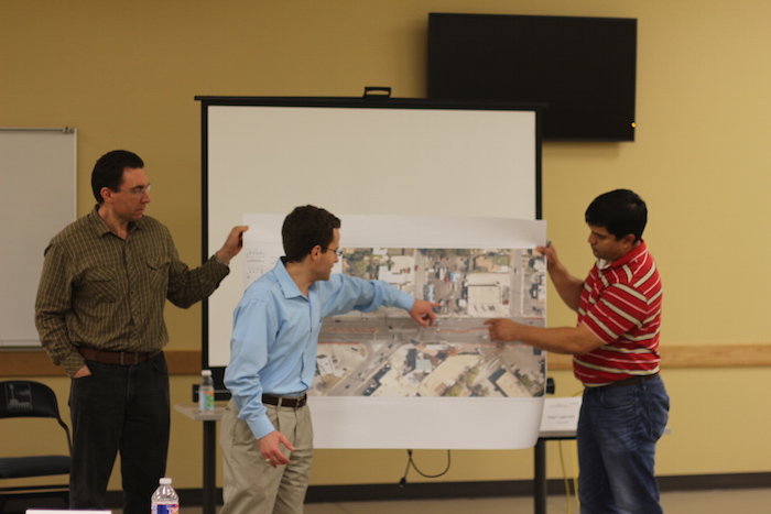 A design team presents its  bicycle lane plan during the Bicycle Facility Design Workshop. Photo by Joan Vinson.