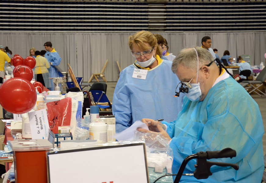 Volunteer dentists worked long hours to provide quality services during a day of free health care services at the Alamodome. Photo by Cherise Rohr-Allegrini.