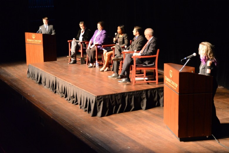 (From left) KSAT 12 Anchor Tim Gerber, Mike Villarreal, Leticia Van de Putte, Mayor Ivy Taylor, Paul Martinez, Tommy Adkisson and Theatre for Change founder Shannon Ivey on stage at The Tobin Center during the Change the Vote mayoral forum. Photo by Page Graham.