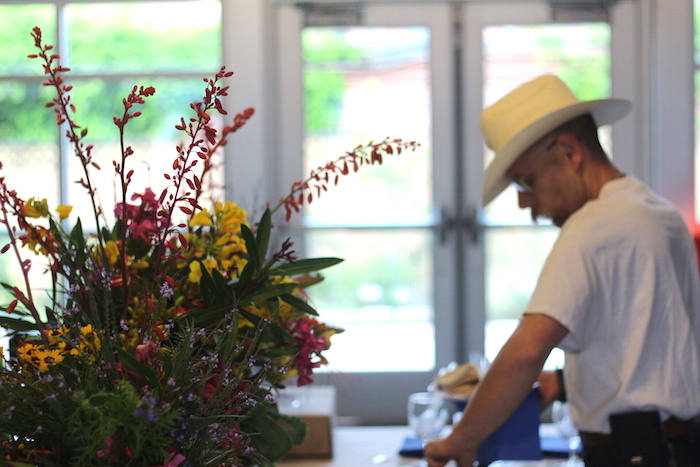 """An attendee reaches for fresh fruit during EcoCentro's """"bEARTHday"""" celebration. Photo by Joan Vinson."""