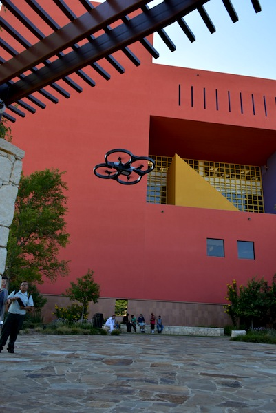 Teens take turns flying a drone in the plaza at Central Library. Courtesy photo.