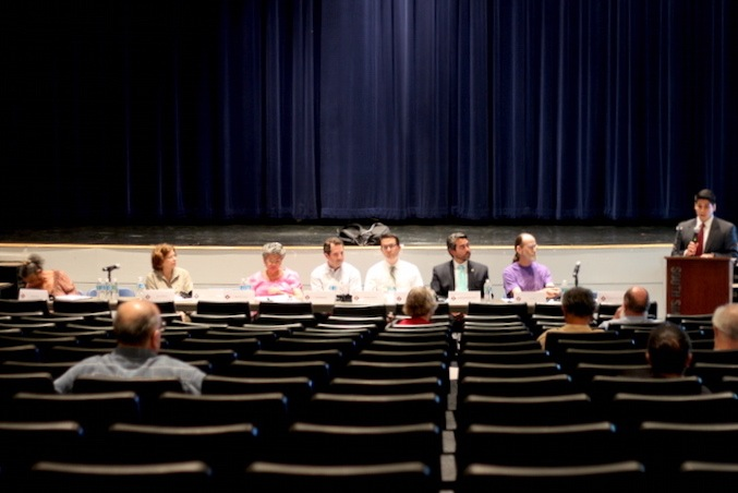 Gentrification Task Force members sit in front of a small crowd at South San Antonio High School. Photo by Joan Vinson.