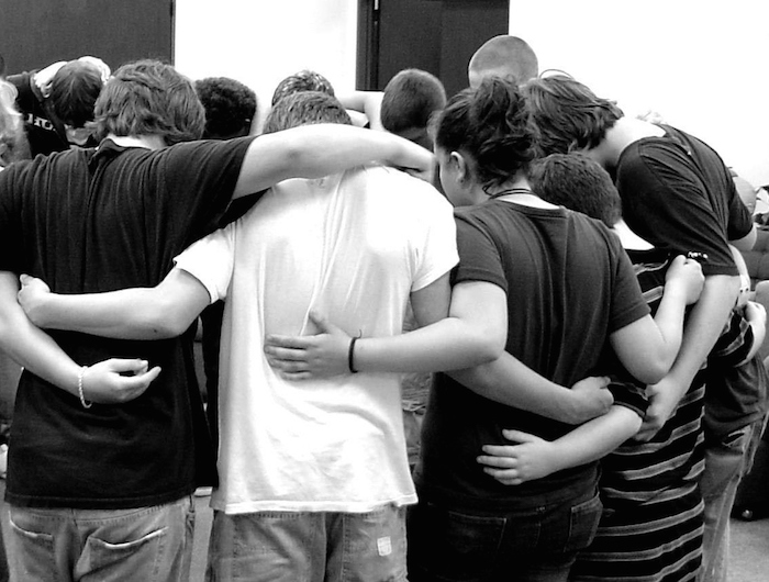 Rise Recovery youth huddle at their group meeting to support each other in the recovery process. Courtesy photo.
