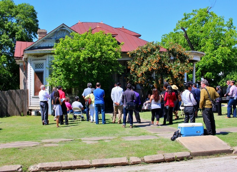 Attendees gather in front of Miguel's home on Thursday. Photo by Page Graham.