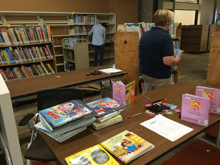 Staff shelving books at SAPL's Encino Branch. A labor of love. Photo by Bekah McNeel