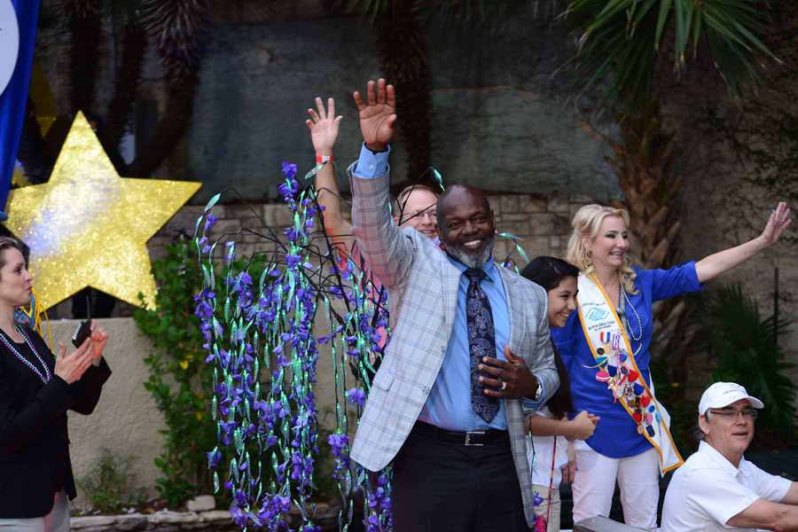 Emmitt Smith Pro Football Hall of Fame Running Back-Texas Cavaliers Grand Marshall waives to the crowd at the 2015 Texas Cavaliers Parade. Photo by Mathew Hiebel.