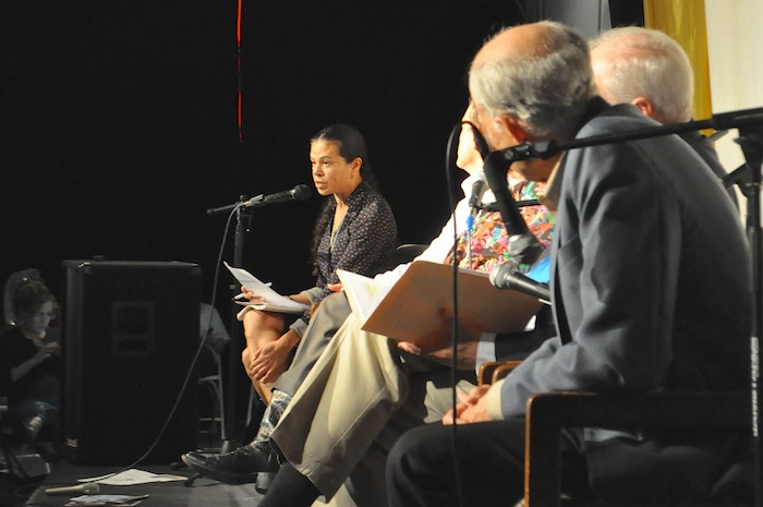 Theresa Canales moderates the Esperanza Peace & Justice Center's mayoral forum. Photo by Iris Dimmick.