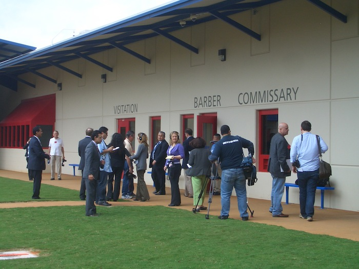 Media scrum at Karnes County Civil Detention Center on opening day, 2012. Photo by Lily Casura.