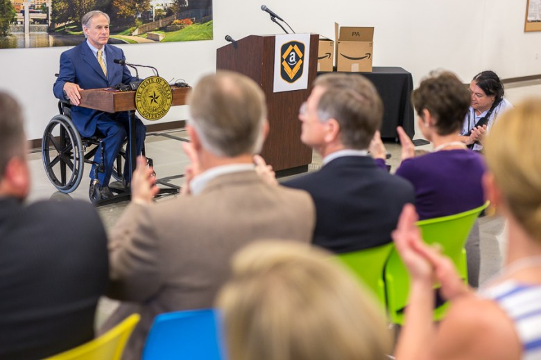 Governor Greg Abbott addresses the recent opening at the Amazon Fulfillment Center.  Photo by Scott Ball.