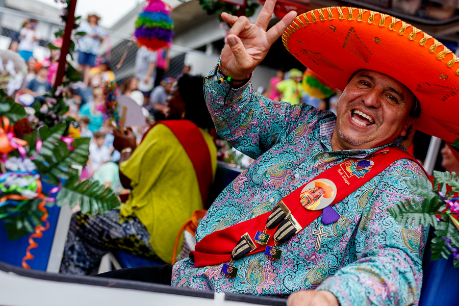 A man poses for a photo during the 2015 Battle of Flowers Parade in downtown San Antonio. Photo by Scott Ball.