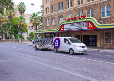 The San Antonio BCycle vehicle transports bikes down Saint Mary's Street. Photo by Scott Ball.