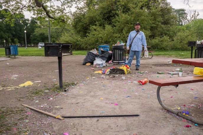 Phillip John Martinez of the City of San Antonio cleans up litter left at Brackenridge Park.  Photo by Scott Ball.