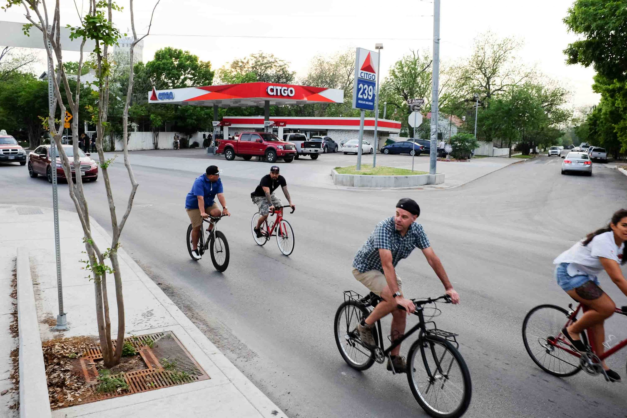 Cyclists ride on South Alamo Street in front of the former church and future home of Frank in Southtown. Photo by Scott Ball.
