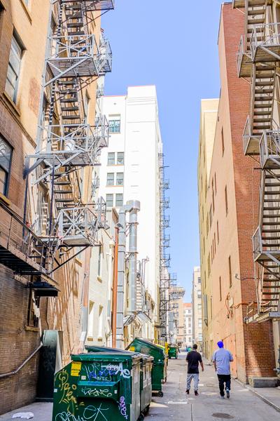 Kollapse walks down an alley near Travis Street. Photo by Scott Ball.