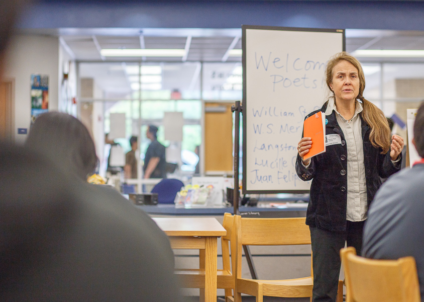 Naomi Shihab Nye shares her knowledge of poetry to students at a poet workshop at Lanier High School. Photo by Scott Ball.