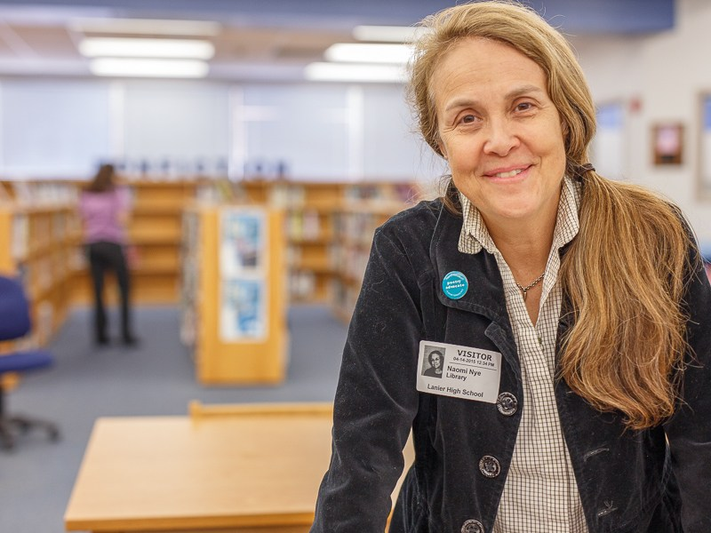 Naomi Shihab Nye poses for a photo at a poet workshop at Lanier High School. Photo by Scott Ball.