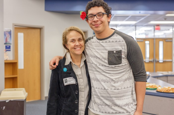 Naomi Shihab Nye poses for a photo with student Roger Romero at a poet workshop at Lanier High School. Photo by Scott Ball.