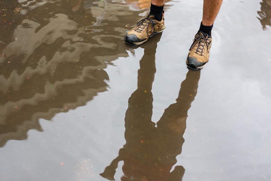 A man stands in one of the many puddles during NIOSA 2015 at La Villita. Photo by Scott Ball.