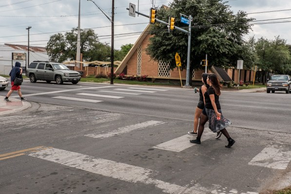 Pedestrians cross the busy intersection of Audubon Drive and San Pedro Avenue. Photo by Scott Ball.