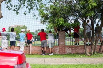 Fans line up along the fence at the Trinity University soccer field to observe the USMNT practice. Photo by Scott Ball.