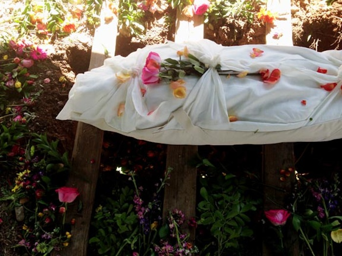A wrapped body in Eloise Woods, a Green Burial Park. Photo courtesy of Ellen Macdonald.