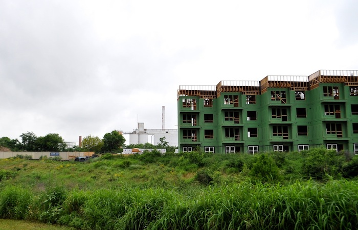 Big Tex mixed-use development construction in early May 2015 on the Eagleland Reach of the San Antonio River. Photo by Iris Dimmick