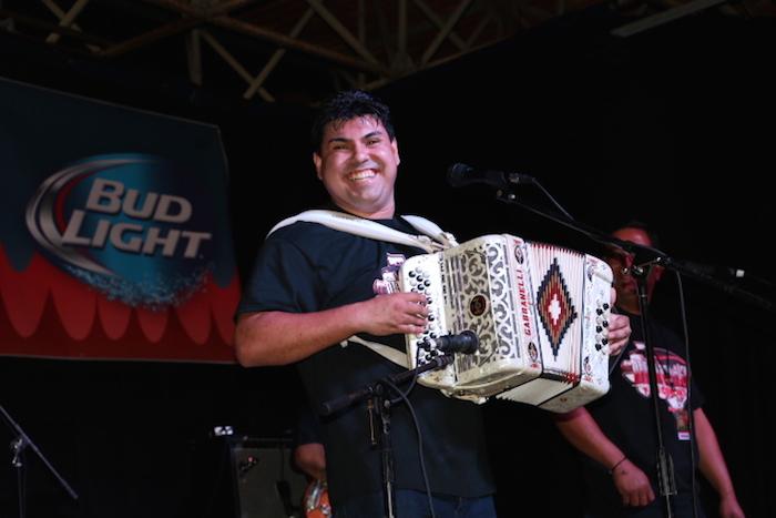Gerardo Mejia plays accordion with Ruben Vela Jr. Y su Conjunto on Friday at the 34th Annual Tejano Conjunto Festival. Photo by Amanda Lozano.