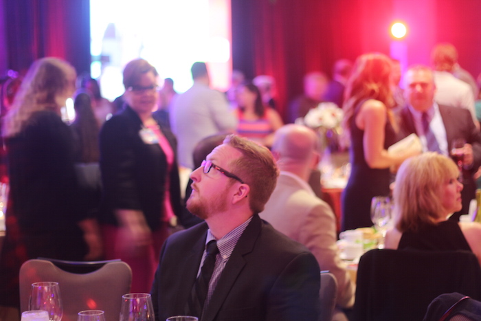 An attendee takes note of the decor during the H-E-B Excellence in Education Awards banquet. Photo by Joan Vinson.