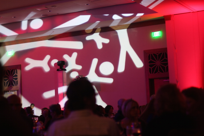 The walls were projected with stick figure images in the Lone Star Ballroom at the JW Marriott Hotel. Photo by Joan Vinson.