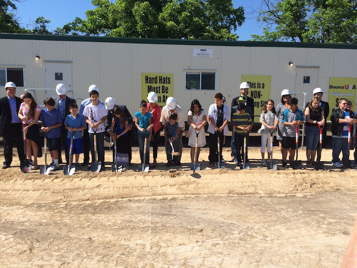Future students join administrators, elected leaders, and philanthropists in the ground breaking ceremony for Carpe Diem Innovative School - Westwood. Photo by Bekah McNeel