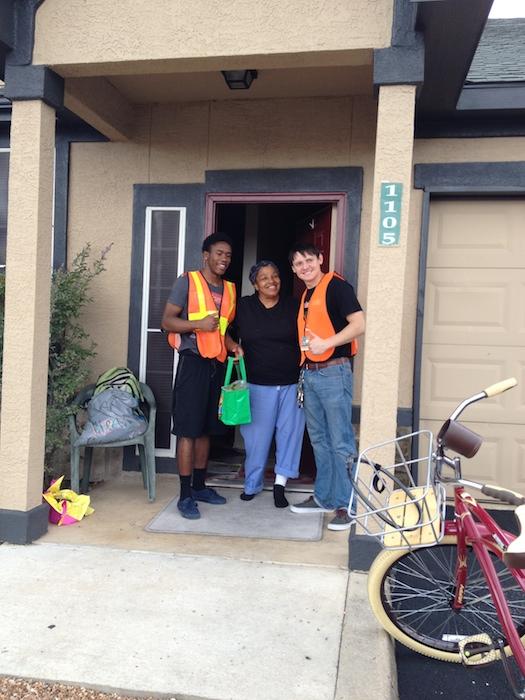 Sam Houston senior John Jackson, produce recipient Jo Ann James, and Sam Houston teacher Rick Trevino. Photo by Junda Woo.