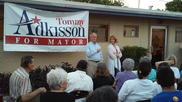 Former Bexar County Precinct 4 Commissioner Tommy Adkisson tells his supporters Saturday night a mayoral runoff election is out of reach. He is joined by wife Karen Barbee Adkisson. Photo by Edmond Ortiz.