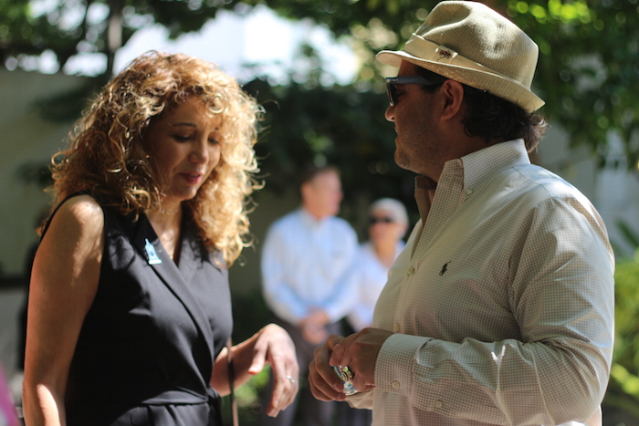 Two attendees converse before the State of Preservation Address at the Spanish Governor's Palace. Photo by Joan Vinson.