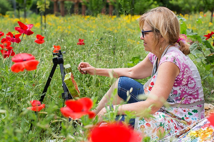 Julene Franki gets inspiration from the red poppies in the garden. Photo by Rachel Chaney.
