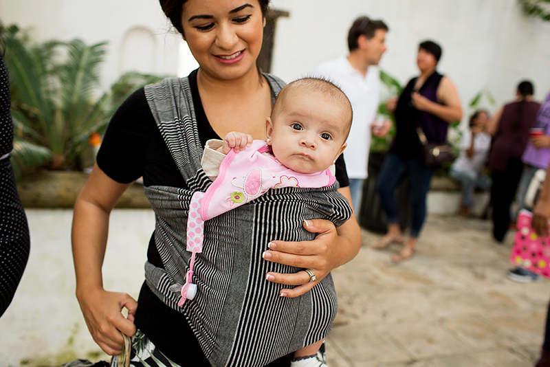 A woman and her baby stroll through the courtyard. Photo by Rachel Chaney.