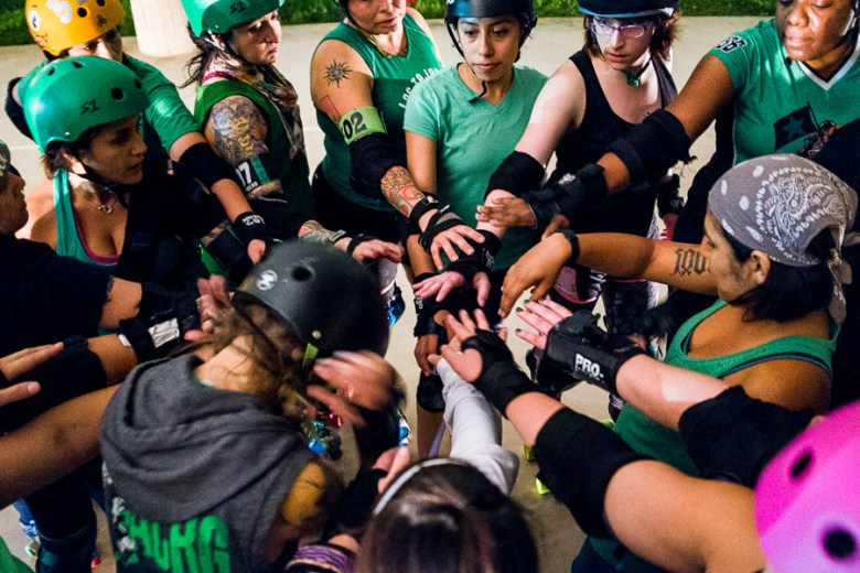 Alamo City Roller Girls end a practice by bringing it in. Photo by Scott Ball.