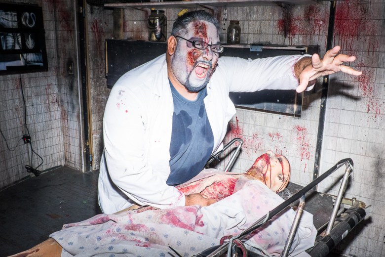 An entertainer reaches out to scare guests at Ripley's Haunted Adventure. Photo by Scott Ball.